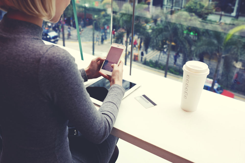 Public Sector - 1158woman on mobile evice in cafe
